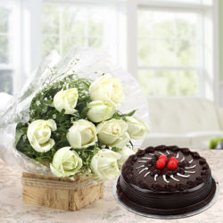 Send this visually appealing and delicious hamper to your loved ones. Delight them with this elegant bunch of 10 white roses with lots of fillers in a paper packing finished with a ribbon and 500 grams of chocolate truffle cake
